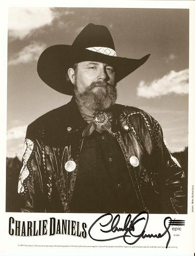 SIGNED, PROFESSIONAL PHOTOGRAPH OF CHARLIE DANIELS:; Country and southern-rock singer and songwriter. Charlie Daniels.