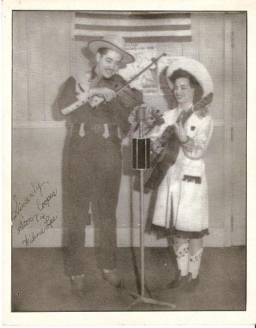 TWO (2) PROFESSIONAL PUBLICITY PHOTOGRAPHS:; One of Stoney & Wilma performing, and one of their young daughter. Wilma Lee, Stoney Cooper.