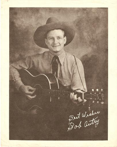 "PRINT FROM PUBLICITY PHOTOGRAPH:; Signed in the negative, ""Best Wishes / Bob Autry."" Bob Autry."