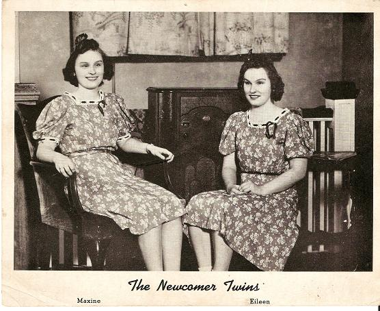PRINT FROM PHOTOGRAPH, SHOWING MAXINE AND EILEEN NEWCOMER SEATED ON CHAIRS IN FRONT OF A CONSOLE RADIO. Newcomer Twins.