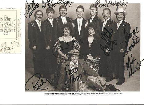 SIGNED, PROFESSIONAL PHOTOGRAPH OF THE 10 MEN AND WOMEN WHO MAKE UP CAMPBELL'S OZARK COUNTRY JUBILEE:; Signed boldly in black ink by all 10 members of the group. With ticket stub from show. Campbell's Ozark Country Jubilee.