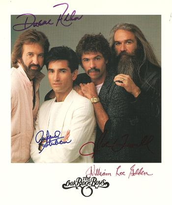 SIGNED, PROFESSIONAL PHOTOGRAPH OF THE OAK RIDGE BOYS:; Signed by all four in various colors of bold ink. Oak Ridge Boys.