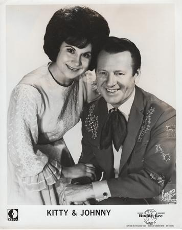 PROFESSIONAL PHOTOGRAPH OF KITTY & JOHNNY:; Country & Western performers. Kitty Wells, Johnny Wright.