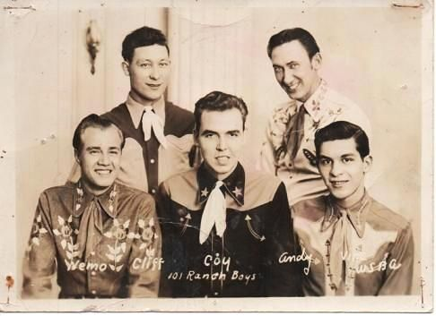 GROUP PHOTOGRAPH OF THE FIVE MEMBERS OF THIS COUNTRY-MUSIC RADIO GROUP, DRESSED IN WESTERN GEAR. 101 Ranch Boys.