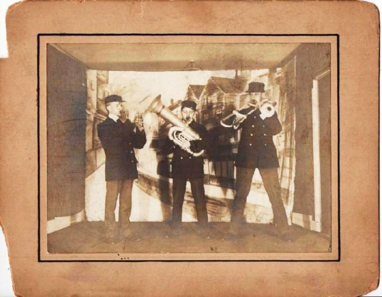 GROUP PHOTOGRAPH OF THE THREE MEMBERS OF THIS UNUSUAL BRASS BAND, COMPRISING CORNET, TUBA, AND SLIDE TROMBONE. Waffenfoofen Band.