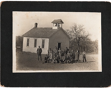 ORIGINAL PHOTOGRAPH OF STUDENTS AND THEIR MALE TEACHER, OUTSIDE A ONE-ROOM SCHOOLHOUSE WITH BELFRY. Oakwood Oklahoma.