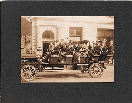 ORIGINAL ALBUMEN PHOTOGRAPHIC PRINT OF A WELL-DRESSED GROUP OF MEN AND WOMEN ABOARD AN OPEN-AIR TOURING BUS, circa 1910. Open Air Tour.