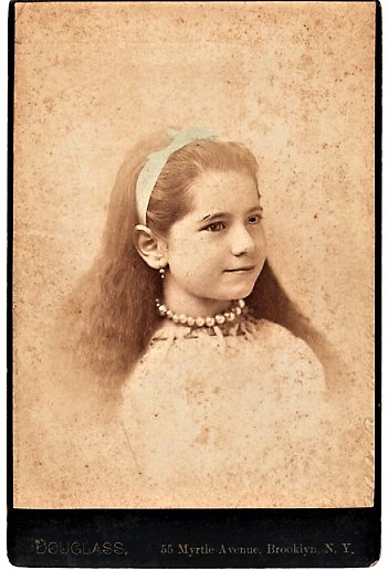 BROOKLYN, NEW YORK PHOTOGRAPHER'S STUDIO PORTRAIT OF GIRL WEARING LACE BLOUSE, PEARL NECKLACE, PENDANT EARRINGS, AND HAIRBAND. Brooklyn / Douglass New York, Charles B?