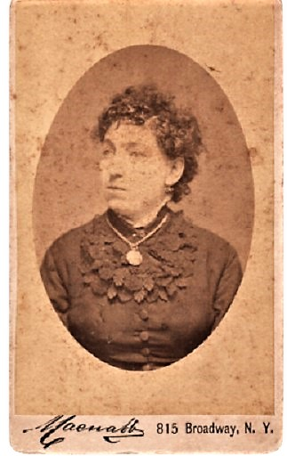 CARTE DE VISITE OF A MIDDLE-AGED WOMAN IN DARK BLOUSE WITH ELABORATE LEAF-DESIGN COLLAR, WEARING A GOLD COIN ON A CHAIN. Francis P. New York City / Macnabb.