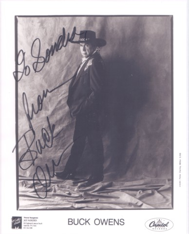 PROFESSIONAL, SIGNED PHOTOGRAPH OF BUCK OWENS:; in elaborate western suit, hat and boots. Buck Owens.