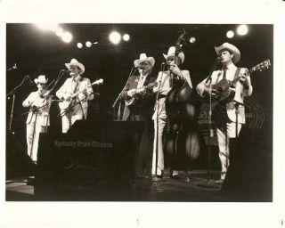 PROFESSIONAL PHOTOGRAPH OF BILL MONROE AND HIS BLUEGRASS BOYS:; 8x10 glossy photo of the group...