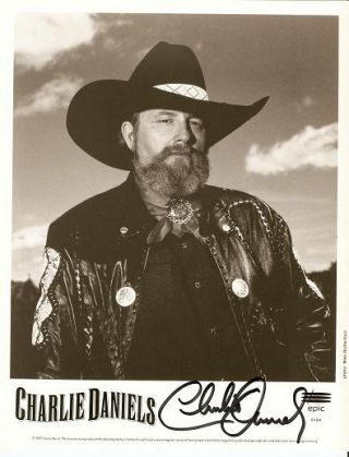 SIGNED, PROFESSIONAL PHOTOGRAPH OF CHARLIE DANIELS:; Country and southern-rock singer and...