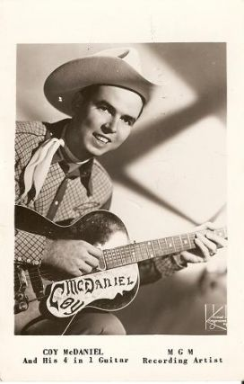 "SIGNED, REAL-PHOTO POSTCARD OF COY McDANIEL AND HIS ""4 IN 1"" GUITAR.; MGM Recording Artist. Coy..."