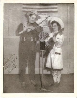 TWO (2) PROFESSIONAL PUBLICITY PHOTOGRAPHS:; One of Stoney & Wilma performing, and one of their...