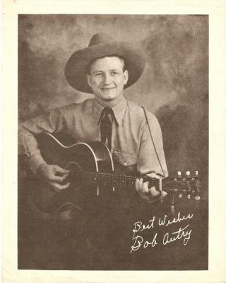 "PRINT FROM PUBLICITY PHOTOGRAPH:; Signed in the negative, ""Best Wishes / Bob Autry."" Bob Autry"