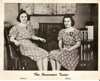 PRINT FROM PHOTOGRAPH, SHOWING MAXINE AND EILEEN NEWCOMER SEATED ON CHAIRS IN FRONT OF A CONSOLE...