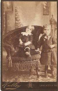 "CABINET CARD PHOTO OF A TODDLER IN AN ELABORATE VICTORIAN CHAIR, AND A STANDING YOUNG BOY:; Handwritten label on back identifies ""Brother Harry Eshbach & Sister Grace Eshbach."" Harry and Grace Eshbach."