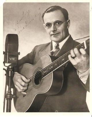"SIGNED, PROFESSIONAL PHOTOGRAPH OF BLUE GRASS ROY. Roy Freeman, ""Blue Grass Roy"""