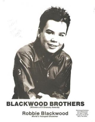 SIGNED, PROFESSIONAL PHOTOGRAPH OF ROBBIE BLACKWOOD, WORLD'S YOUNGEST DRUMMER:; Blackwood...