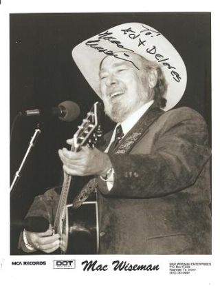 SIGNED, PROFESSIONAL PHOTOGRAPH OF MAC WISEMAN IN PERFORMANCE WITH HIS GUITAR:. Mac Wiseman
