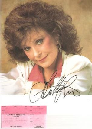 SIGNED, PROFESSIONAL PHOTOGRAPH OF LORETTA LYNN:; With a ticket stub from her July 14, 1991...