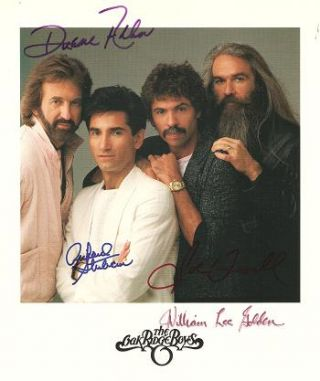 SIGNED, PROFESSIONAL PHOTOGRAPH OF THE OAK RIDGE BOYS:; Signed by all four in various colors of...