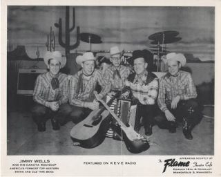 PROFESSIONAL PHOTOGRAPH OF JIMMY WELLS & HIS DAKOTA ROUNDUP:; Country & Western performers. Jimmy...