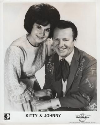 PROFESSIONAL PHOTOGRAPH OF KITTY & JOHNNY:; Country & Western performers. Kitty Wells, Johnny Wright