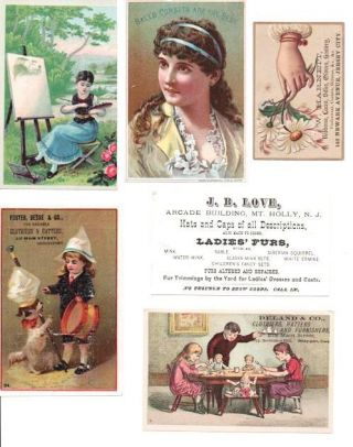 GROUP OF SIX CARDS PRINTED IN FULL COLOR. Clothing Trade Cards.
