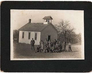 ORIGINAL PHOTOGRAPH OF STUDENTS AND THEIR MALE TEACHER, OUTSIDE A ONE-ROOM SCHOOLHOUSE WITH...