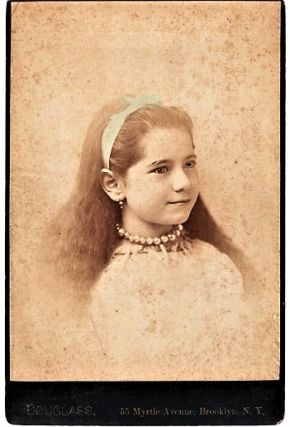 BROOKLYN, NEW YORK PHOTOGRAPHER'S STUDIO PORTRAIT OF GIRL WEARING LACE BLOUSE, PEARL NECKLACE,...