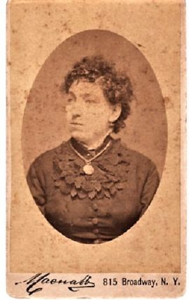 CARTE DE VISITE OF A MIDDLE-AGED WOMAN IN DARK BLOUSE WITH ELABORATE LEAF-DESIGN COLLAR, WEARING...