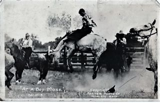REAL-PHOTO POSTCARD OF A RODEO BAREBACK RIDER ON A BUCKING BRONCO, POSTMARKED 1920. Miles City...